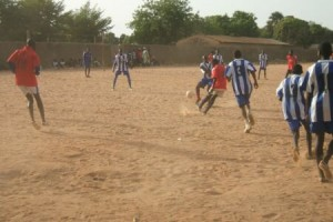 Youth playing a soccer game
