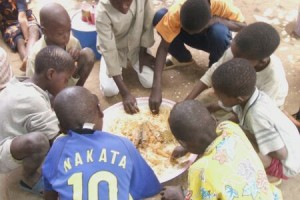 Street children come to eat a meal