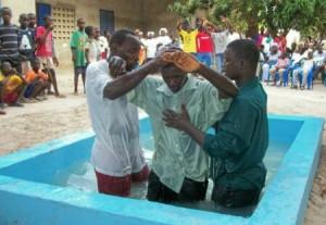 Baptizing new converts in Senegal