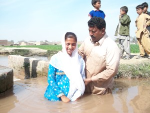 Pastor in Pakistan baptizing a new convert.