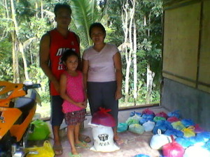 A family receiving rice.