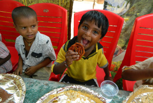 Orphan children receive a meal