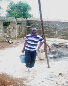Pastor Joseph Fallah working on church building