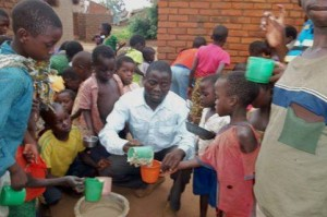 Pastor Gregory feeding the children