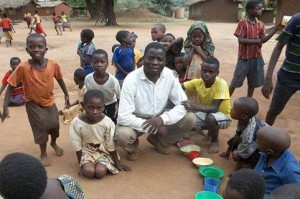 Pastor Gregory with the orphan children