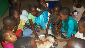 Serving needy children in our Tanzania Church with food in December 2014