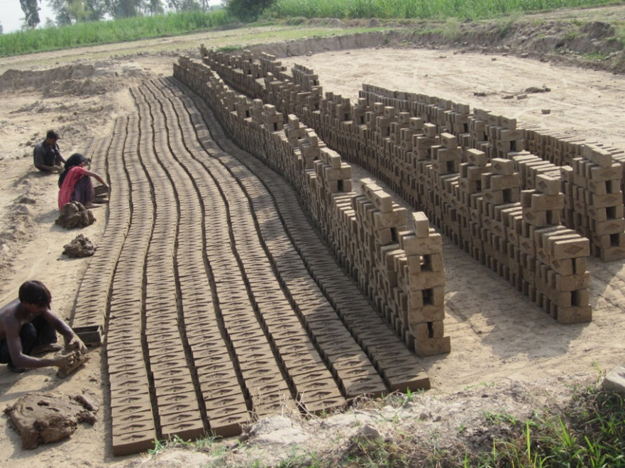 Poor family working at brick kiln