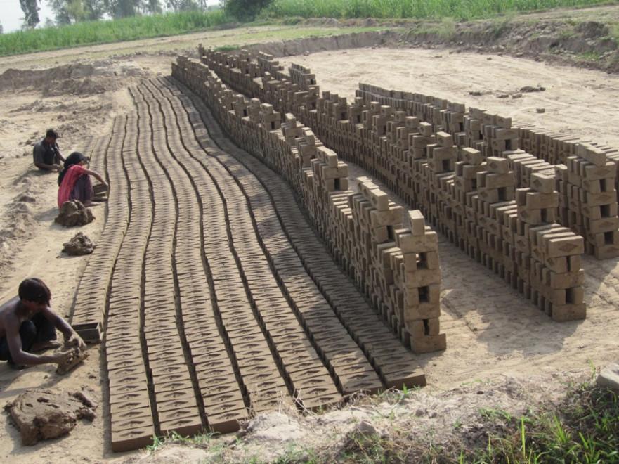 Poor family working at brick kiln