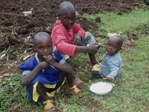 Orphans enjoying their meals