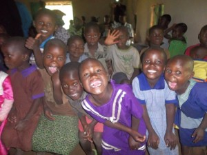 Orphans rejoicing together after thier meal