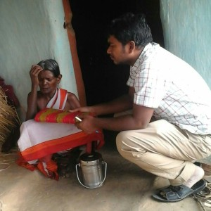 Pastor Samuel gives a saree to a widow and prays for her