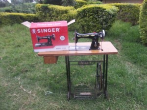 One purchased new Singer brand sewing machine