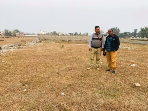 Peter (on right) with house parent visiting the land for the children's home.