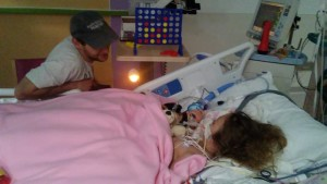 Playing  a game with daddy from her bed in PICU